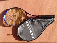 Short handled tennis racket suitable for learner, complete with protective cover. Good condition.