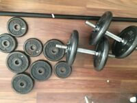 Cast iron weights set. 2 dumbells, 6ft barbell and 35kg plates
