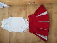 Cheerleading red and white outfit. Girls age 11-13 yrs