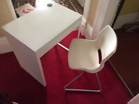 White desk with matching white chair.