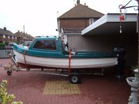 here is my beautifull 17 ft orkney style river / sea day boat