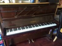 Upright Piano. Free - we have upgraded and would like someone to have this.