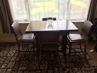 Art Deco dining table and chairs.