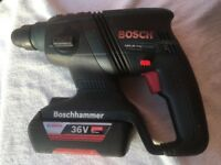 Bosch 36v Brushless Hammer Drill, Li-ion Battery and Charger, in very good condition.