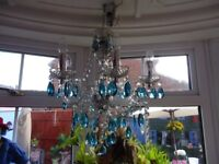 chandelier with teal coloured droplets