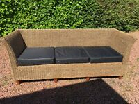 Heavy duty Wickerwork 3 seater couch and matching coffee table with glass top for sale