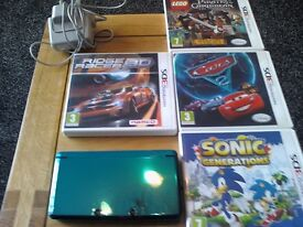 nintendo 3 ds console with 4 3ds games and charger