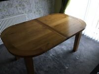 Heritage extending oval oak dining table