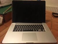 Macbook pro (15 inch late 2013) latly refurbished, with a couple of dents and scratched underneath.