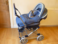 Mamas and Papas Dinky Denim carry cot/pram/push chair/stroller, suitable for ages 0-2 years old.