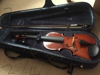Selling one half sized and one 3/4 sized violins