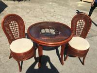Cane table and two chairs. Wicker.