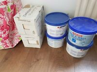 4 boxes of 43 white bathroom tiles and 4 tubs of adhesive
