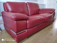 Red leather couch and chair