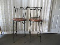 PAIR OF BLACK METAL HIGH BACK HIGH BAR STOOLS WITH WOODEN SEATS.