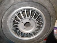 nice set of mgb alloy wheels/will fit other cars