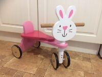 Pink wooden rabbit trike
