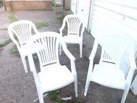 white plastic garden chairs x4