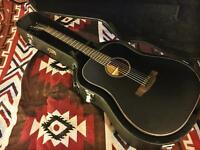 Black Hudson 100A acoustic guitar with case. Great for beginners