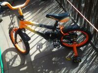 orange and black kids bike £10