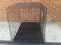 """Dog cage 4'long 2'6""""wide 2'8""""high metal tray 2 doors 1 of which as been repaired."""