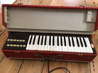 Vintage electronic keyboard and carry case.