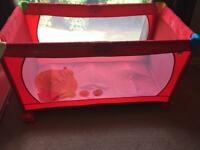 Red Hauck travel cot **brand new**