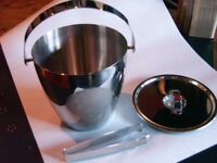 ICE BUCKET IN POLISHED STAINLESS STEEL. BRAND NEW CONDITION WITH LID AND TONGUES.