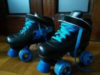 Roller skates - used - in box - good condition - adult size 2