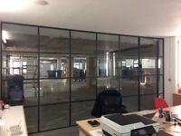 Black framed office partitioning with doors plus folding partition