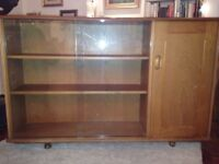 This is a side cabinet with sliding glass doors