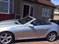 Immaculate condition, super low mileage, silver Mercedes SLK convertible