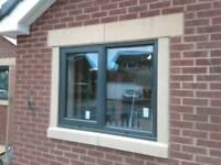 Sandstone and aluminium windows