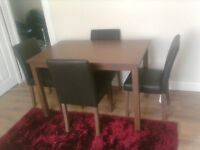 walnut / dark wood table and four faux leather chairs excellent condition