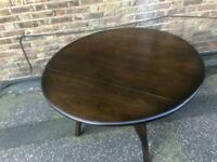 Ercol drop leaf dining table excellent original condition