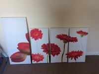 Set of 3 red flower canvases and a single larger red flower canvas