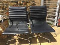 Black Retro arm chairs matching in working order. Recliner 360 swivel on wheels