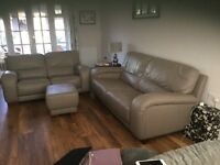2 and 3 seater leather sofa with matching footstool.