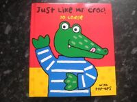 Pop-up book 'Just like Mr Croc!' by Jo Lodge. 6 pages which all have different animations. Fun!