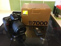 Nikon D7000 with 18-105mm VR lens and remote.