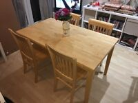 Set of four chairs and a table, Like new quality solid light pine