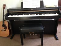 Roland Piano with weighted keys, user manual and Roland adjustable piano stool