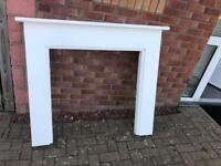 White fire surround with marble hearth and marble surround