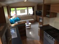 Spacious 2 bed static caravan for sale in Newquay Cornwall on family park. Close to beaches!