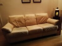 Two cream leather sofas for sale