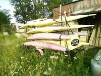 Kayaks/canoes and trailer.