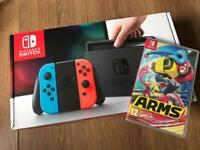 Brand new Nintendo switch in neon with sealed ARMS game receipt and full warranty