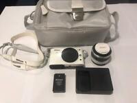 Nikon 1 J1 Compact System Camera + Nikon 1 NIKKOR VR 30-110mm