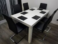 Dining table and 6 leather chairs.