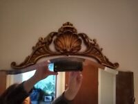 Very beautiful vintage mirror with golden decorative mount